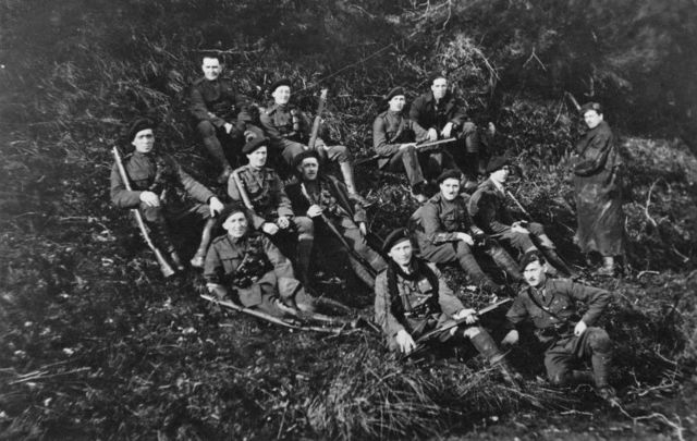 Men, possibly of the Royal Irish Constabulary (RIC) resting in the hills of Tipperary, Ireland, during the Irish War of Independence, 1921.