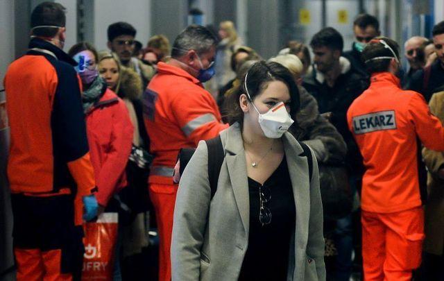 Passengers at Krakow International Airport in Poland are screened for coronavirus on February 26.