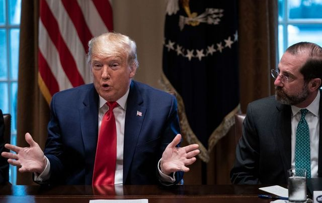 President Donald Trump speaks as Secretary of Health and Human Services Alex Azar looks on during a meeting with the White House Coronavirus Task Force and pharmaceutical executives in Cabinet Room of the White House on March 2, 2020 in Washington, DC.
