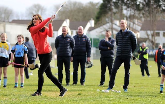 Kate Middleton tries her hand at hurling as Prince William watches on in Co Galway.