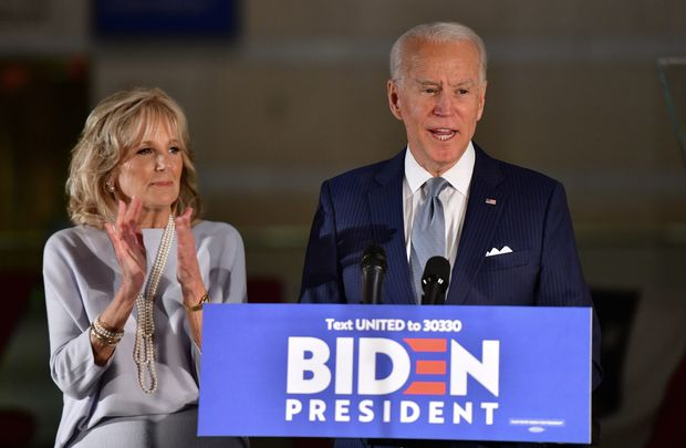 Former vice president Joe Biden and with his wife, Dr. Jill Biden, address a small crowd of supporters in Philadelphia, Pennsylvania. \n