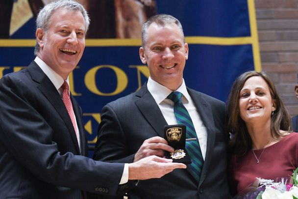 New York City Mayor Bill de Blasio, NYPD Commissioner Dermot Shea and his wife Serena on Shea's swearing in day on December 1.