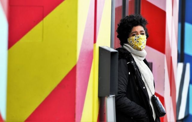 February 24, 2021: A person wearing a face mask in Dublin City Center.