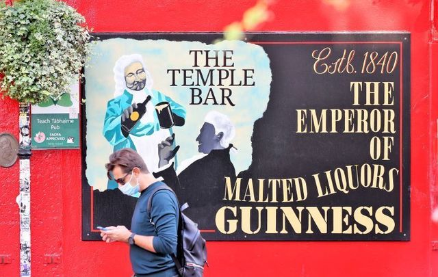 September 17, 2020:  A masked pedestrian passes by The Temple Bar Pub in Dublin\'s City Center.