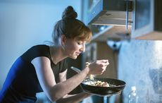 Thumb redhead woman cooking home getty