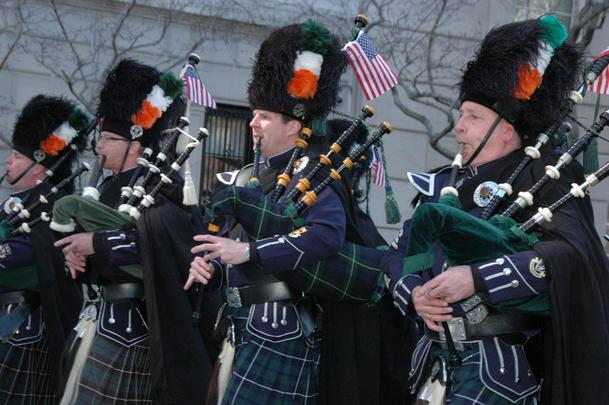 Pipers walking up Fifth Ave, in the New York St. Patrick\'s Day parade.