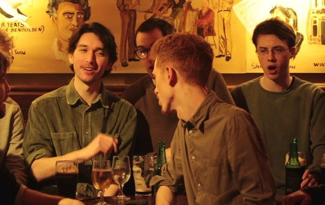 """The Ramparts singing \""""The Rocky Road to Dublin\"""" at The Stag\'s Head pub in Dublin, Ireland."""