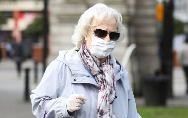 Woman wearing a facemask in St. Stephen\'s Green, in Dublin.