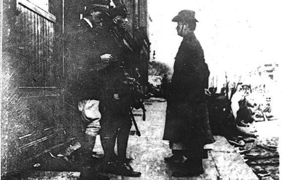 Airbrushed out: A famous photo of Pearse handing over the 1916 surrender, what we don\'t see is Elizabeth O'Farrell standing right next to him.