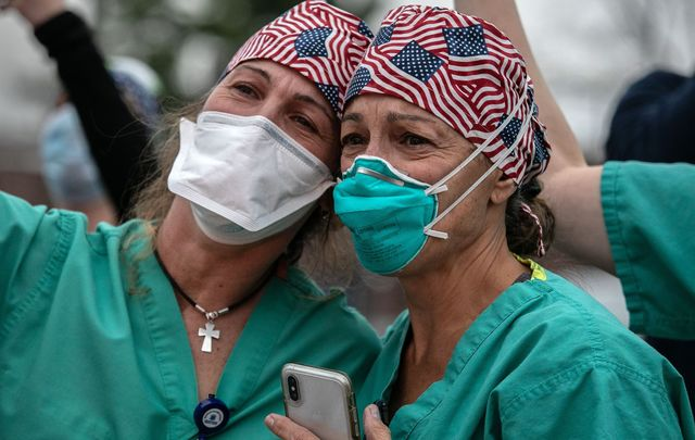 Emotional EMS workers dealing with the onslaught of COVID-19 in New York.