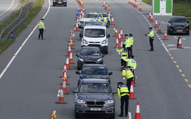 Garda officers enforce lockdown restrictions on the N7.