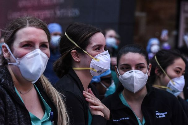 New York healthcare workers take a break during the COVID-19 pandemic.