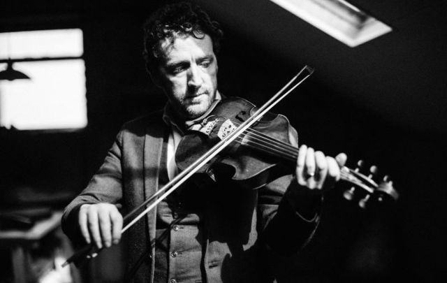 Irish fiddler player Colm Mac Con Iomaire performed as part of the \'Courage\' series from Other Voices in Ireland.