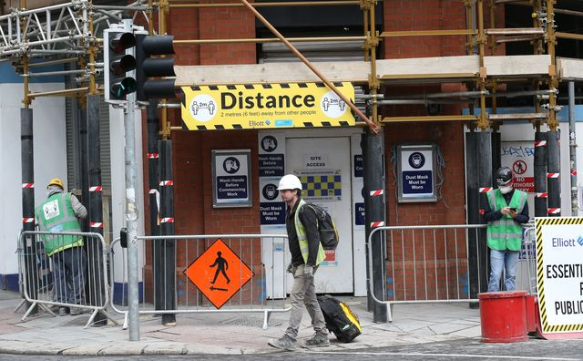 Irish builders return to work, with social distancing.