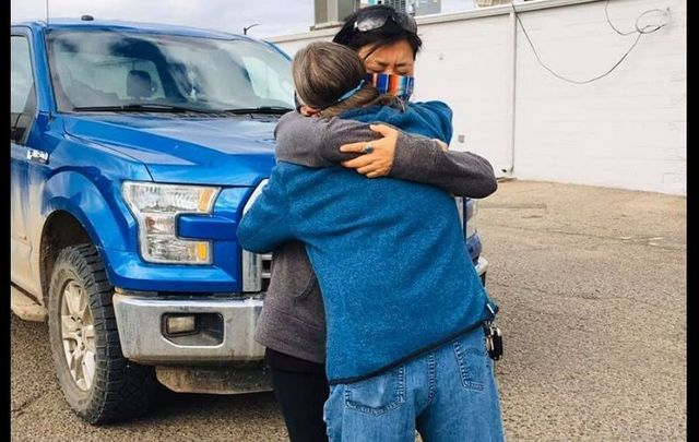 Claudia Morris embraces Ashlee Lewis of Compassionate Colorado after donating a water tank and trailer for the Navajo Nation.