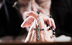 Thumb mi woman hands praying rosary beads getty