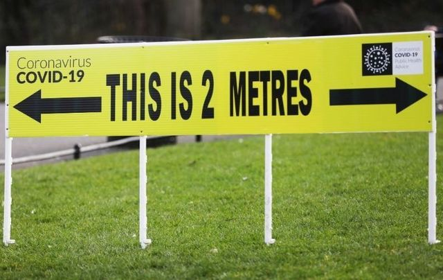 A sign showing the distance of 2 meters to help people with social distance issues in St Stephen's Green in Dublin on March 25, 2020.