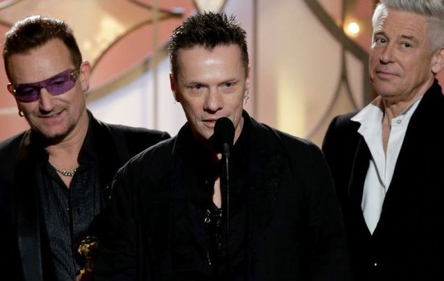 "Larry Mullen, Jr accepting the award for Best Original Song - Motion Picture for ""Ordinary Love\"" by U2 from \""Mandela: Long Walk to Freedom\"" during the 71st Annual Golden Globe Awards."
