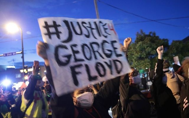 Protestors gather in Minneapolis to demand justice after George Floyd\'s killing.
