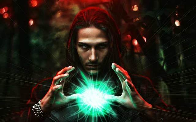 A long-haired man holding a mystical glowing orb.