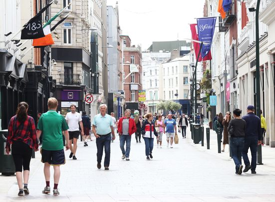 Grafton Street thronged with people as Irish government eases the COVID lockdown.
