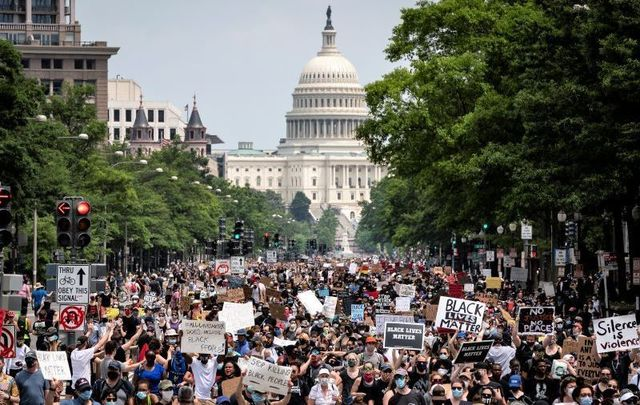 Demonstrators march down Pennsylvania Avenue during a protest against police brutality and racism on June 6, 2020, in Washington, DC.