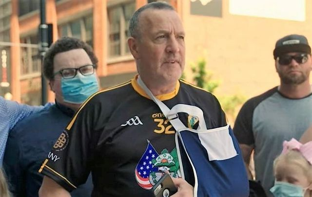 Malachy McAllister speaking with his supporters before he surrendered himself in New Jersey on June 9.