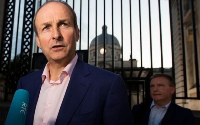 Michéal Martin arrives at government buildings with his team to finalize a deal on a coalition government.