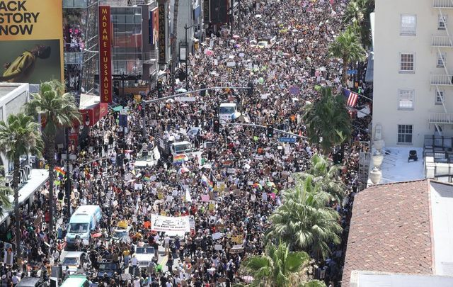 JUNE 14: Protesters crowd Hollywood Boulevard during the All Black Lives Matter solidarity march as unrest continues in the wake of the death of George Floyd in Los Angeles, California. Black LGBTQ leaders organized the June 14 event, meant to honor Tony McDade, the transgender man shot by Tallahassee police last week.
