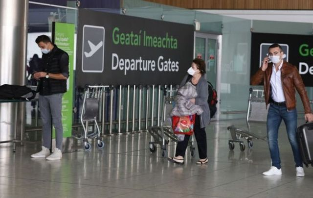 Passengers at Dublin Airport, where flights to the US have virtually halted.
