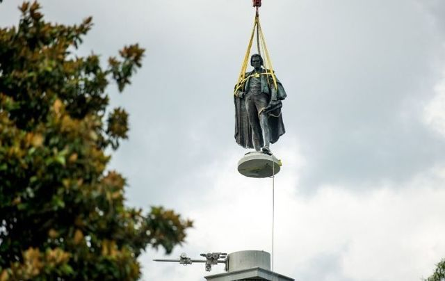 Workers remove the statue of Irish American Vice President John Calhoun in South Carolina.