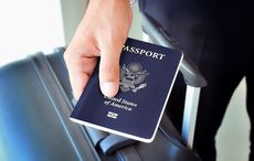 Thumb us passport travel suitcase airport   getty