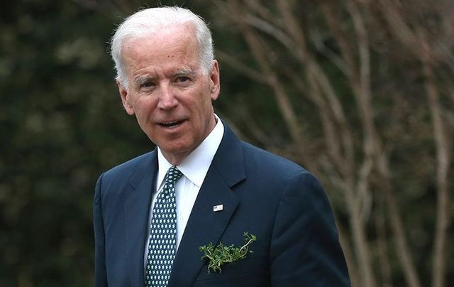 Vice President Joseph Biden waits for the arrival of Taoiseach Enda Kenny of Ireland, at the Naval Observatory, on March 14, 2014, in Washington, DC. Vice President Biden hosted a breakfast for the Irish Prime Minister in honor of St. Patricks Day on Sunday.