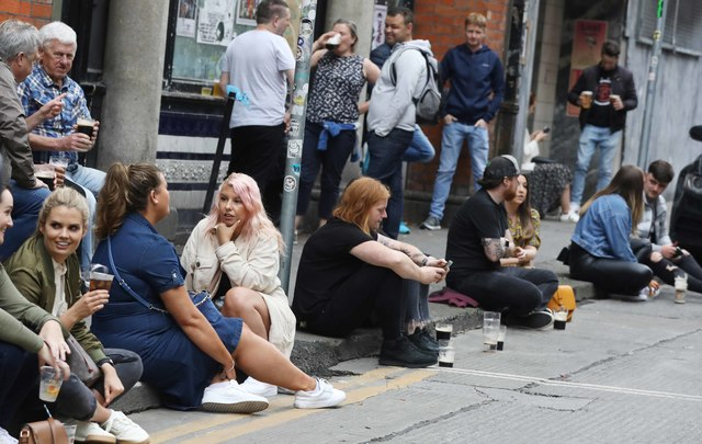 People drinking outside a pub on Dame Court in Dublin on Saturday afternoon.