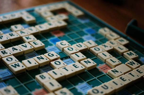 The North American Scrabble Players Association is considering banning more than 200 slurs.