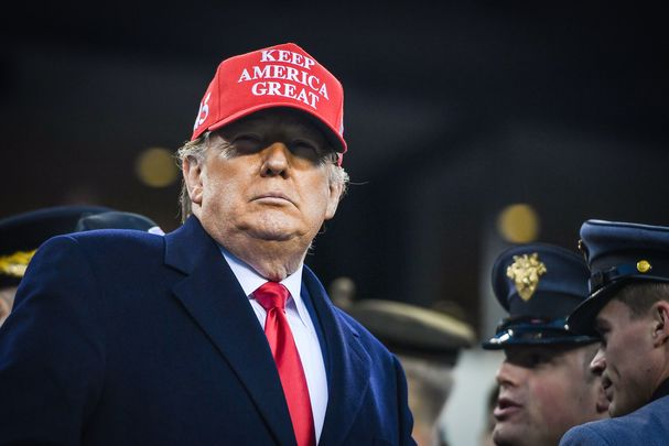 "President Donald J Trump, wearing a ""Keep America Great\"" hat."