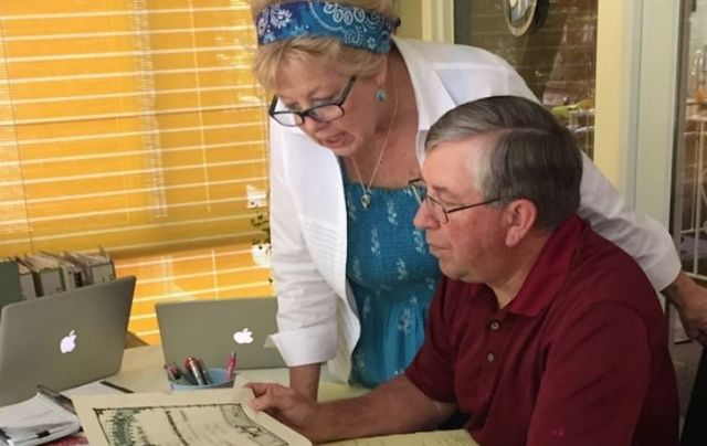 Kate and Mike reviewing family records in the Kennedy family bible passed down through four generations. Like other members of the Irish American diaspora, strong bonds exist between their family members and the people of Ireland.