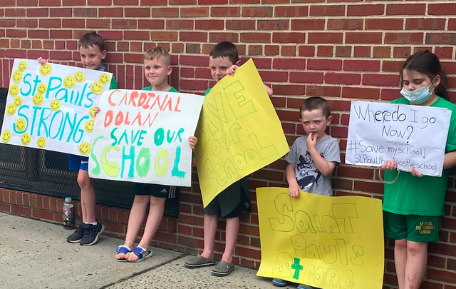 Children protest outside St. Paul the Apostle School in Yonkers.