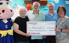 Two friends split $22 million lotto jackpot thanks to 30-year-old pact