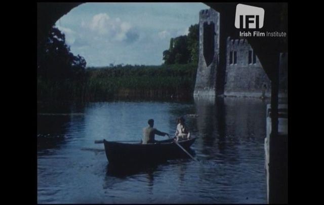 "A man and a woman outside of Ashford Castle in Co Mayo in 1946, as featured in Desmond Egan\'s ""By Corrib Waters\"""