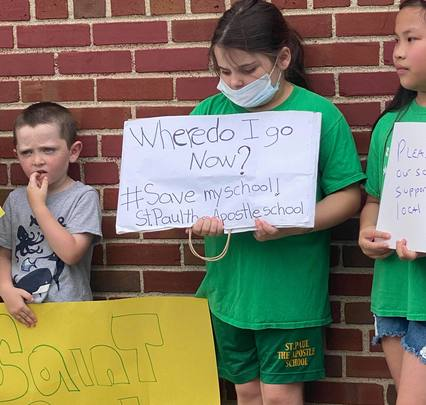 Children protest the school\'s closure outside St. Paul the Apostle in Yonkers.