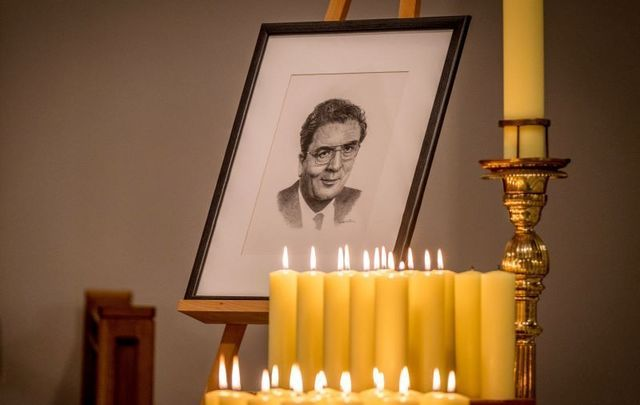 August 4, 2020: A Portrait of John Hume surrounded by candels lit by members of his family and colleagues