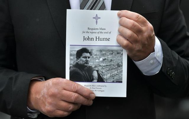 August 5, 2020: A mourner holds an order of service as the funeral takes place for John Hume at St Eugene\'s Cathedral in Derry.