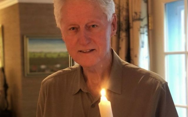 President Clinton lit a candle for peace and said a prayer in honor of his friend, John Hume.