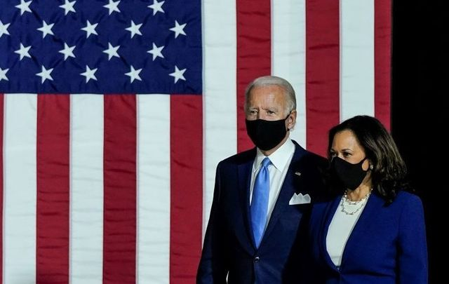 Joe Biden and Kamala Harris arrive to deliver remarks at the Alexis Dupont High School on August 12, 2020, in Wilmington, Delaware.