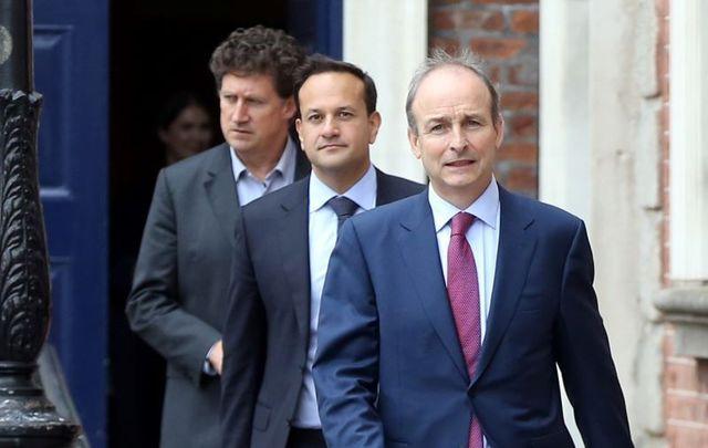 June 29, 2020: Irish government leaders Eamon Ryan, Leo Varadkar, and Micheál Martin leaving their first Cabinet meeting.