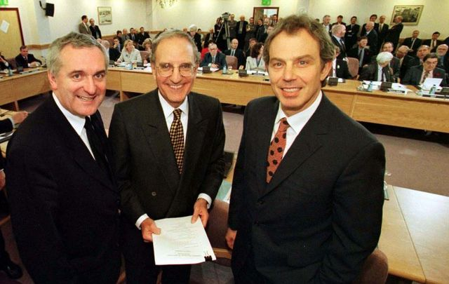 April 10, 1998: Taoiseach Bertie Ahern, US Senator George Mitchell, and British Prime Minister Tony Blair at Castle Buildings in Belfast after they signed the peace agreement.