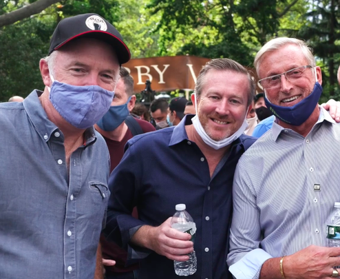 Martin Whelan, owner of Stout NYC Group; Mark Fox and Joe Smith, owner of Bobby Van's, at the September 14 City Hall rally.