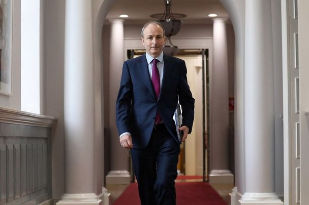 January 12, 2021: Taoiseach Micheal Martin with a copy of the Final Mother and Baby Home Report on his way to a live video link with survivors and stakeholders.