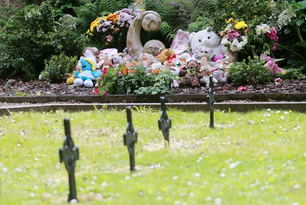 Children\'s teddy\'s and toys along with flowers sit at the \'Little Angels\' memorial plot in the grounds of Bessborough House in Blackrock, Cork